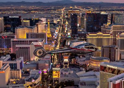 Maverick Helicopters flying over Las Vegas in the evening - Unravel Travel TV